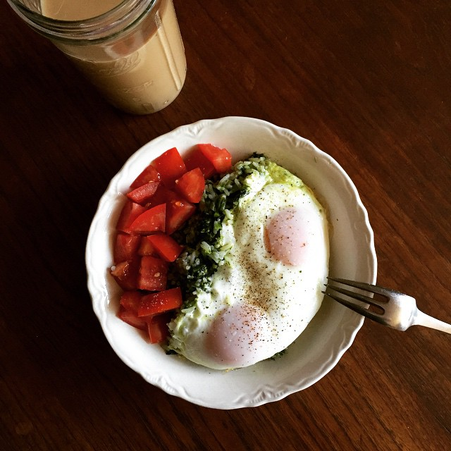 A good birthday breakfast! Garlicky rapini with leftover rice. Sunny side eggs. Tomatoes. Iced cold brew. #breakfast