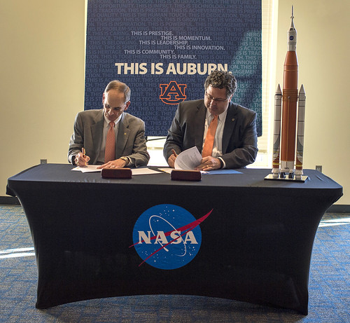 John Mason and Todd May signing a Space Act Agreement.