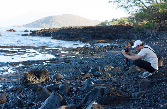 Photographer on the Volcanic Beach
