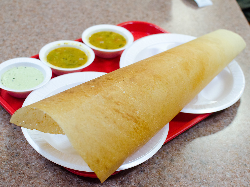 Great atmosphere delicious food and  Paper Dosa