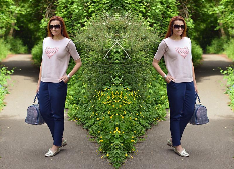 Pink motif sweater and loose navy pants
