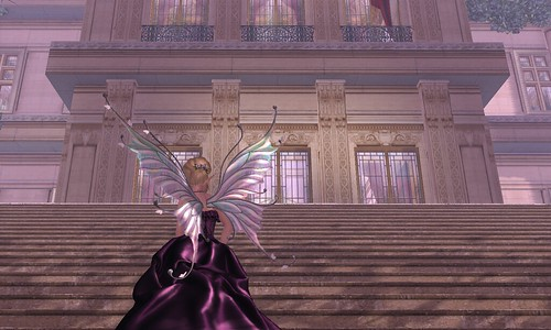Image Description: The front of a large building with stairs going up to it; a woman in a purple dress is bottom left, with an open window top right.
