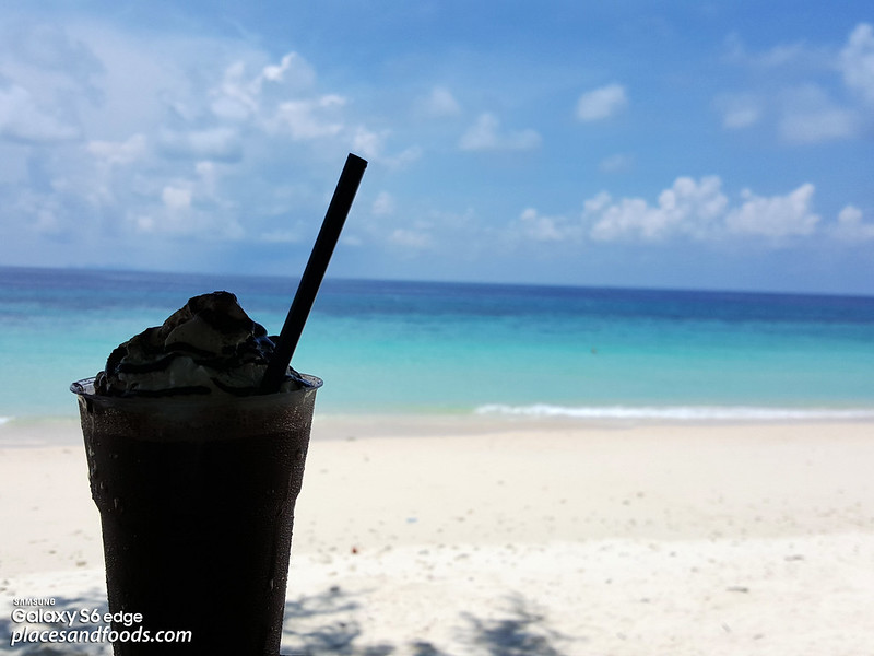 maiton island chilling with drink