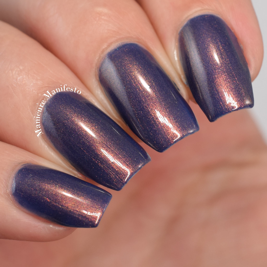 Blue with copper shimmer nail polish