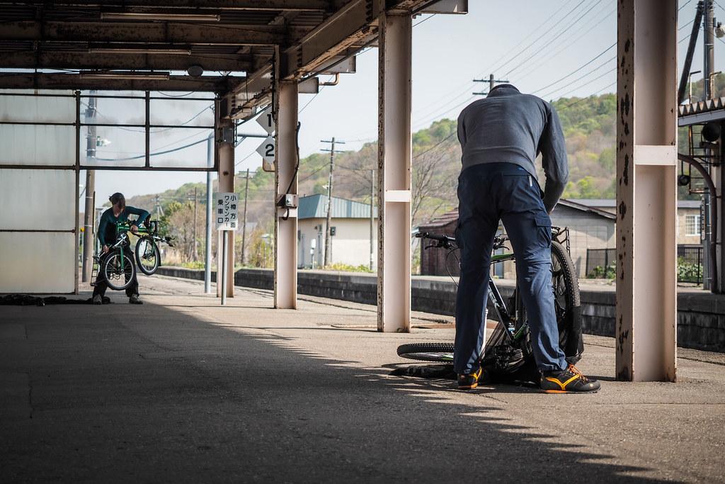 Packing bicycles for the train at Kuromatsunai Station, Hokkaido, Japan