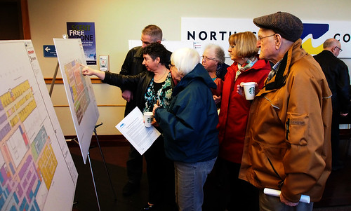 NIHP Clinical Project Manager Christina Lumley, left, discusses floor plans for the new hospitals at the March 11, 2015 Comox Valley community information meeting.
