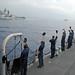 Halsey Sailors wave at passing Indian navy ships.