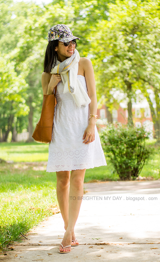 floral cap, linen scarf, white eyelet dress, cognac brown tote