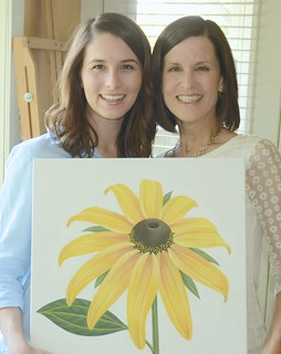 Sarah and Laurie Koss with flower painting