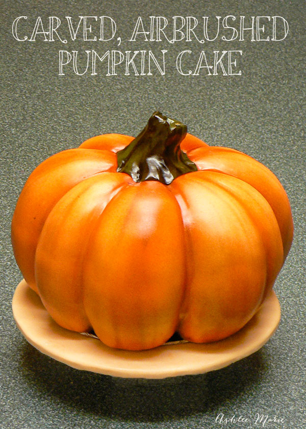 this carved and airbrushed pumpkin cake is pefect as a centerpiece for any party in the fall