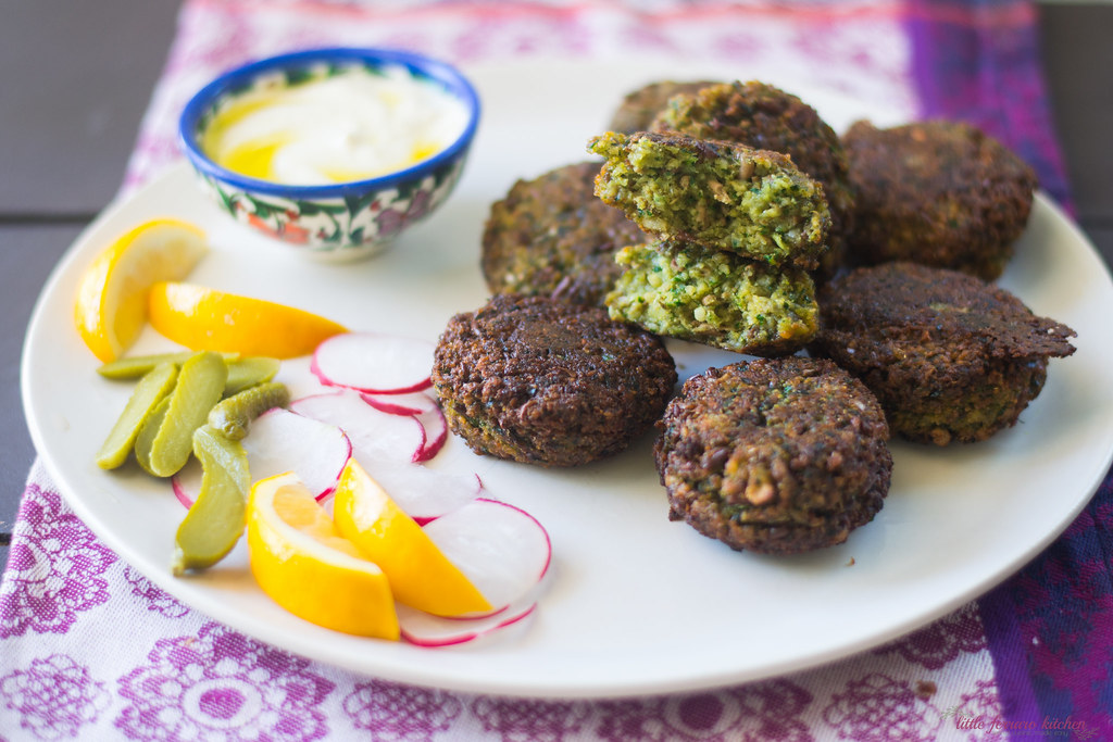 Homemade fava bean falafel filled with aromatics of parsley, cilantro and spices and perfectly fried. Serve with pickles, radishes and tahini sauce.