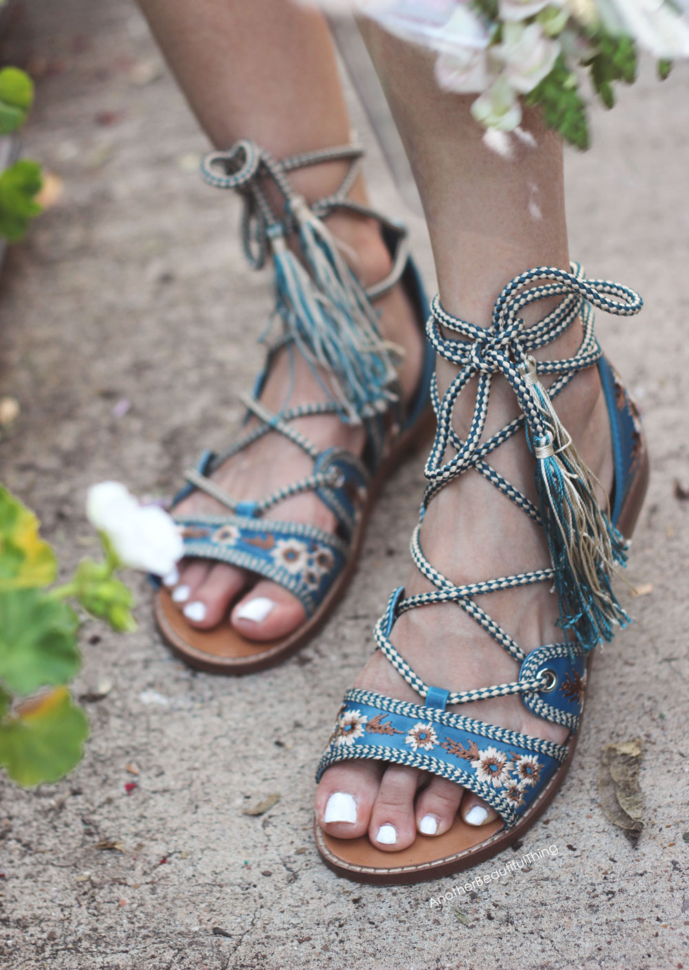 Embroidered lace up sandals with tassels