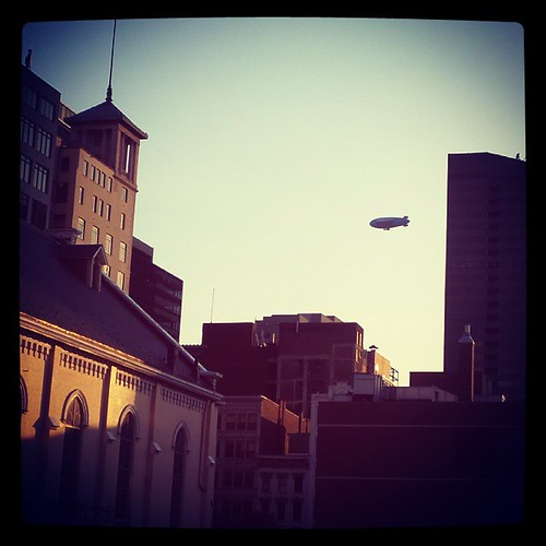 The DirecTV blimp was floating above downtown Cincinnati the evening...