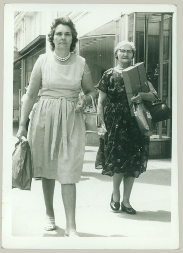 Two women by an itinerant photographer