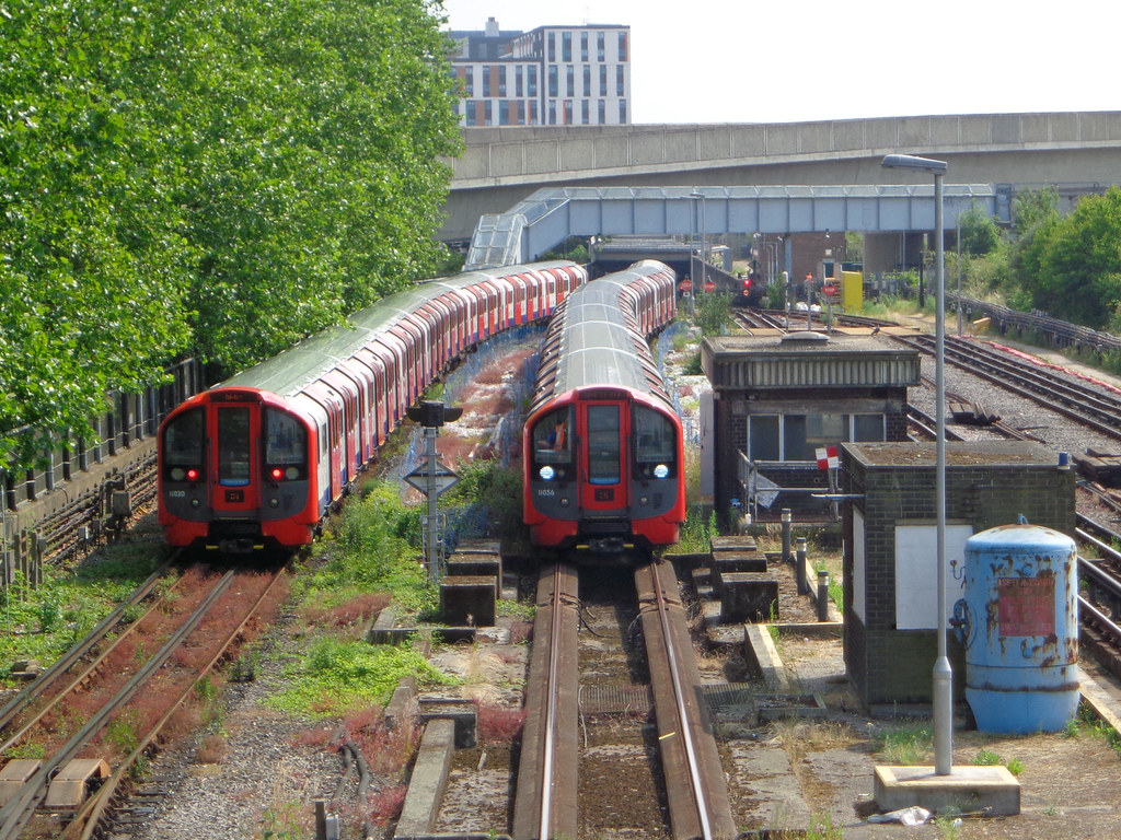 Two Victoria Line Trains One Emerging From The Platforms