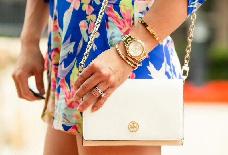 cute & little blog | petite fashion | sheinside blue floral romper, tory burch ivory wallet on chain, nail bracelet, love screw bangle, citizens crystal boyfriend watch