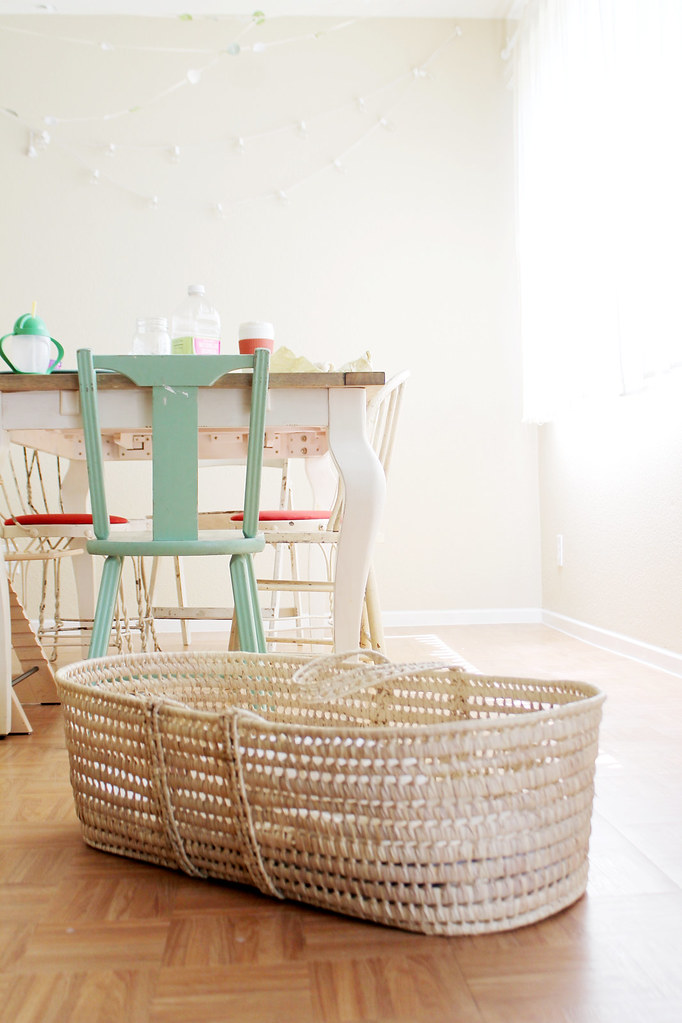 moses basket in dining room