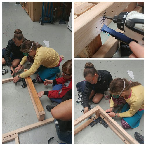 It takes teamwork to make sure the shelf frame is screwed together squarely.