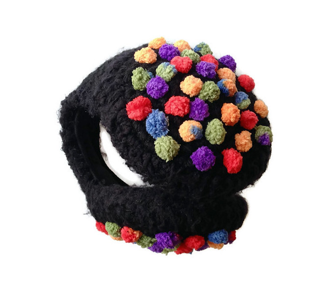 black earmuffs with full color pompom