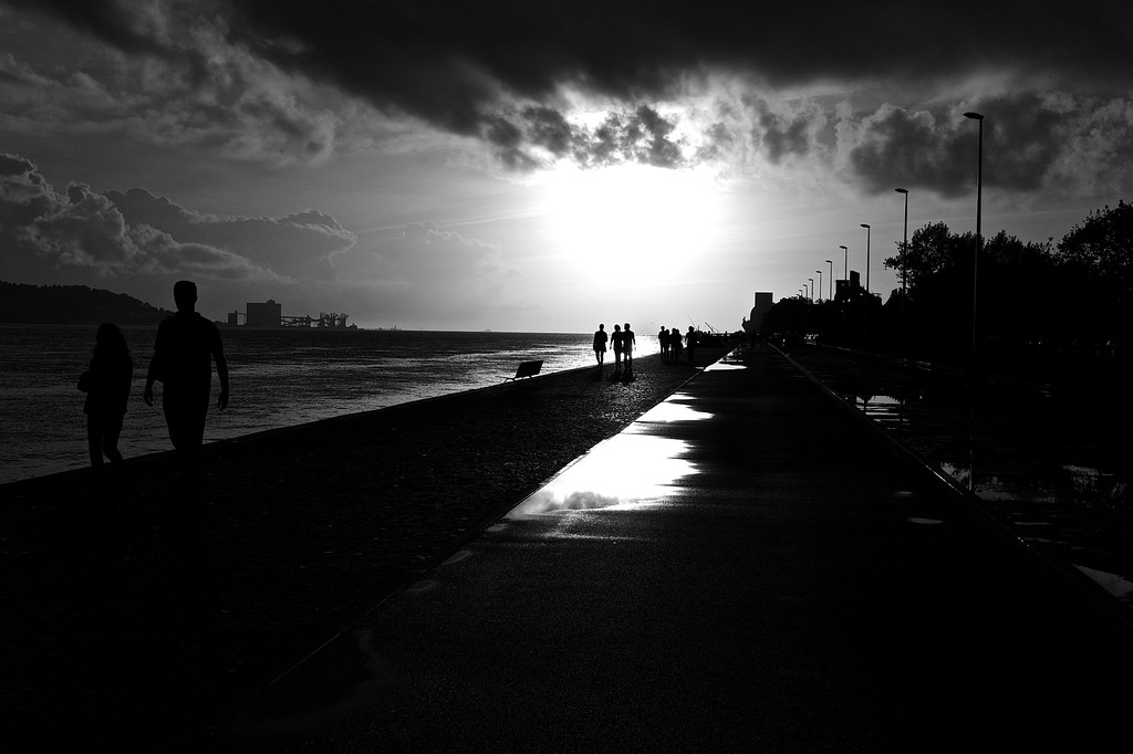 lisbon sunset in black and white coming home from a storm