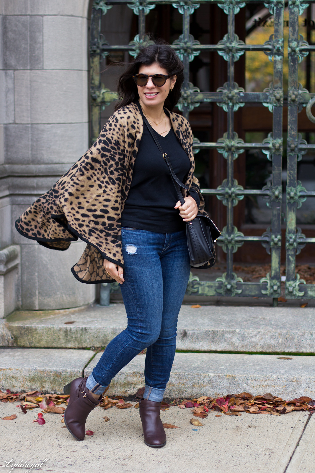 leopard poncho, jeans, black tee, brown booties.jpg