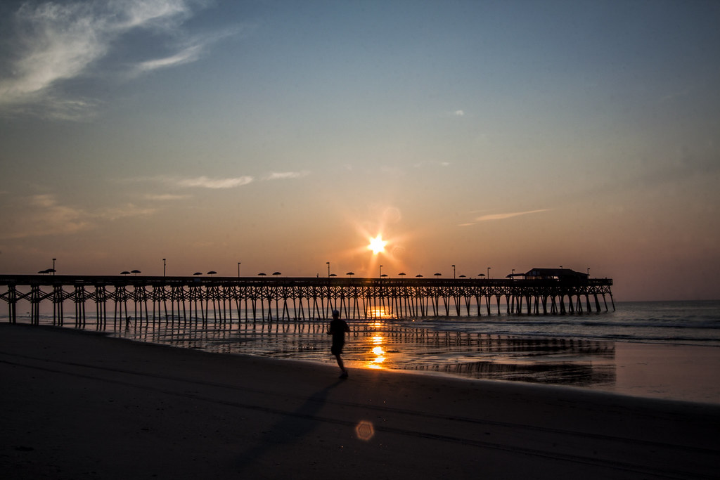 Morning Run At Sunrise At Garden City Pier Taken At