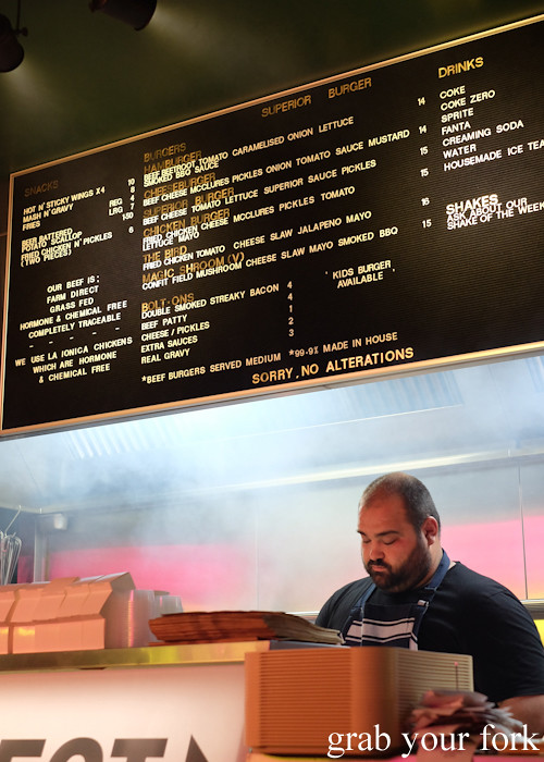 Jovan Curic and the menu board at Superior Burger, Wakeley