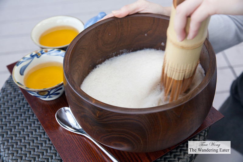 Traditional Okinawa Tea Ceremony of Buku buku tea - A type of frothed jasmine tea