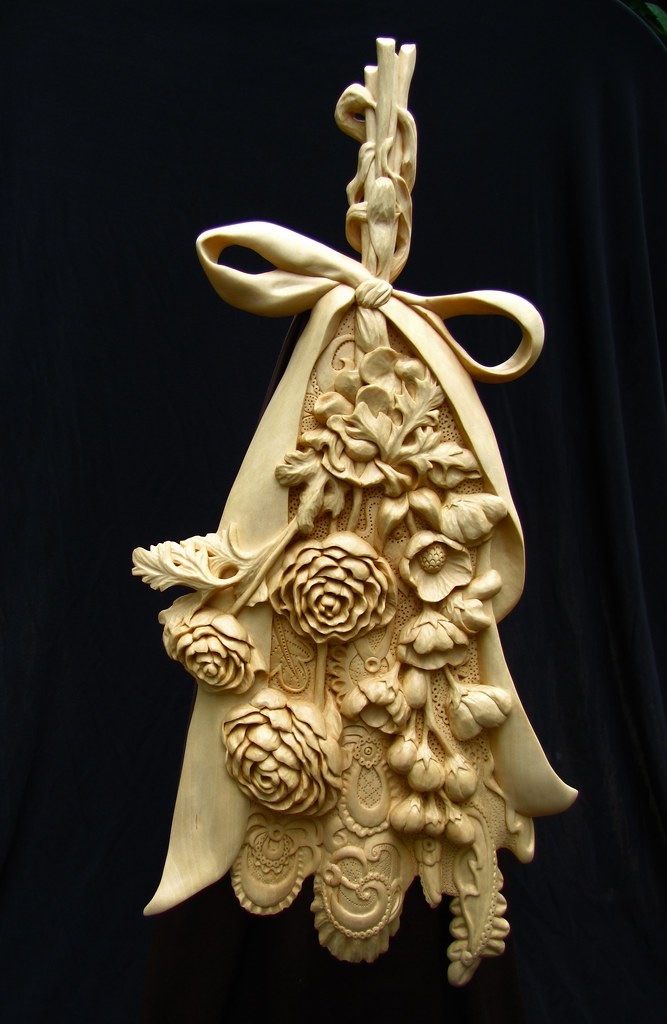 Woodcarving flowers on lace deb bergum flickr