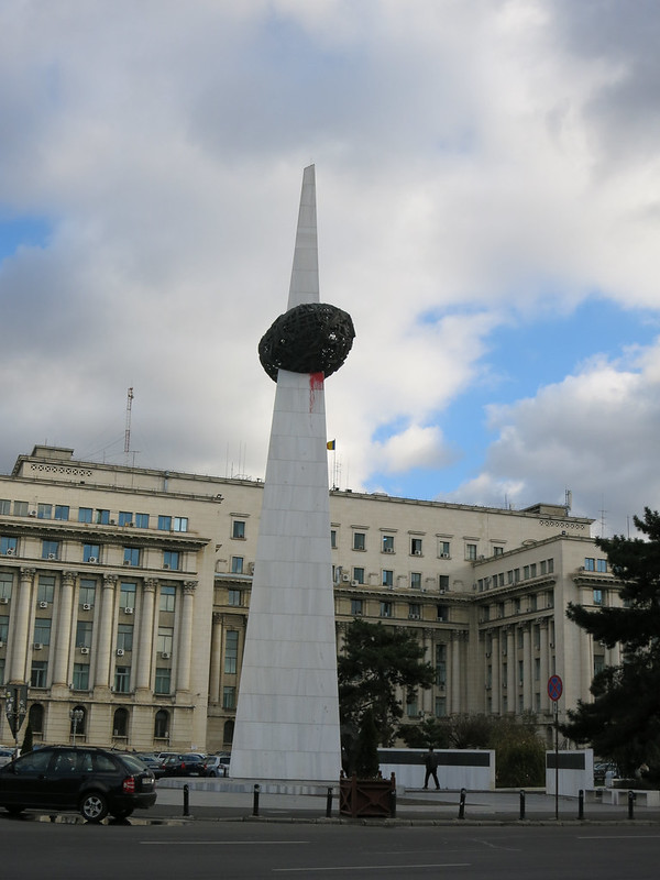 Memorial of Rebirth sculpture stands in front of former communist headquarters