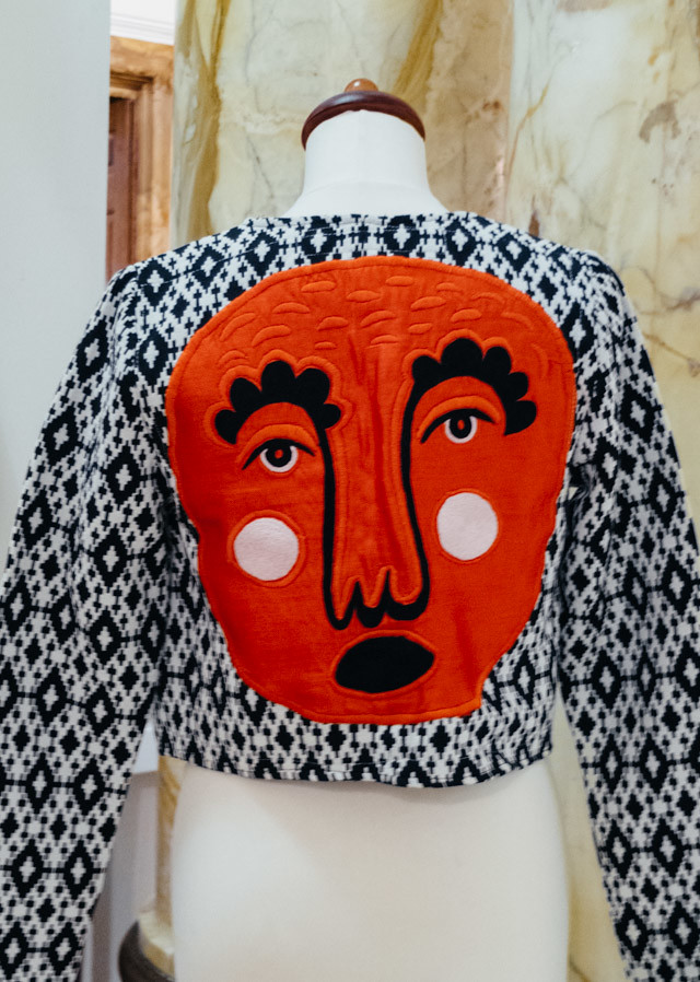 jacket with appliqued face