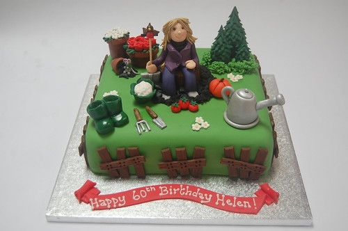 This one has it all - flowers and veg, tools, wellies and even a little mouse and robin! Helen's Gardening Cake - from £80.