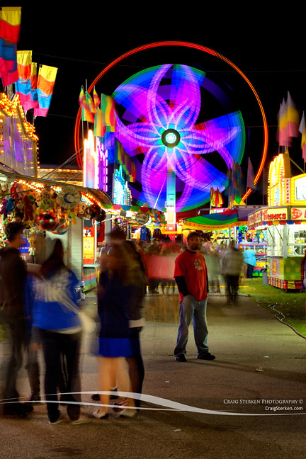 Midway at the Midland County Fair | A twirling ride at the ...