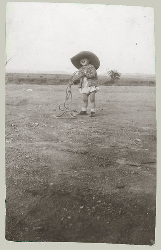 Cow girl with a rope and hat