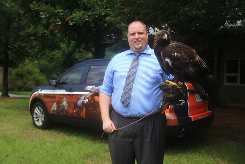 Dr. Seth Oster is pictured holding an eagle