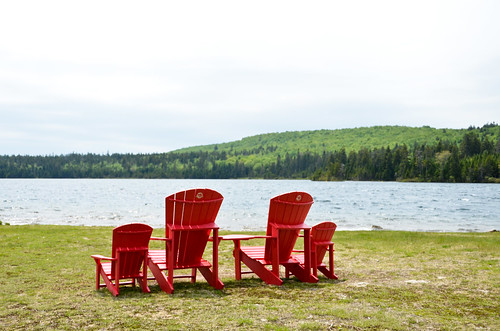 Red chairs on the lake