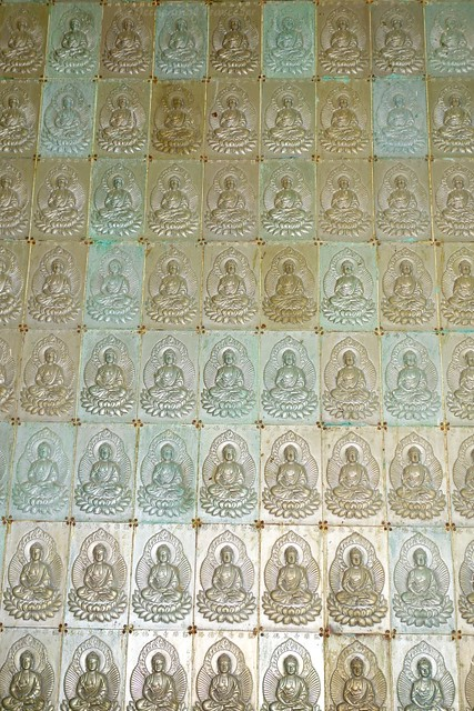 Pagoda walls adorned with images of Buddha
