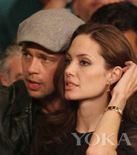 Peter and Angelina Jolie wearing a Cartier Tank series Watch NBA games