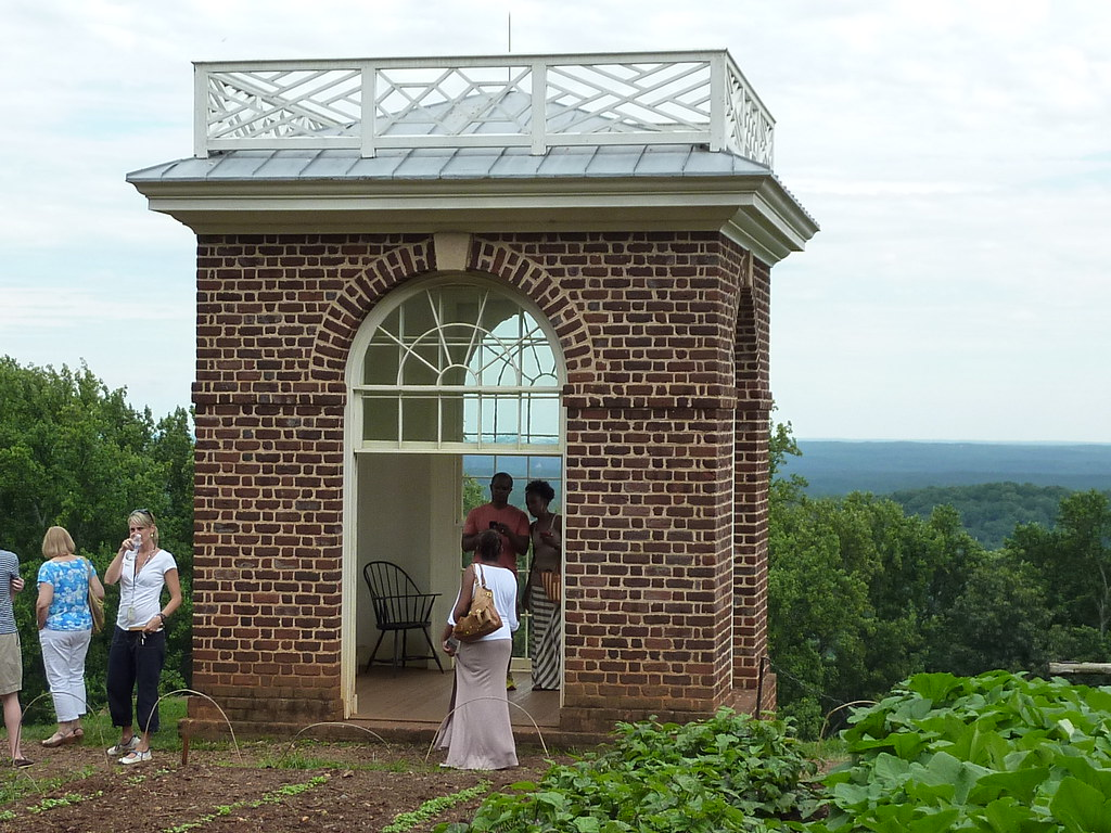 visitors to monticello gather at a garden pavilion