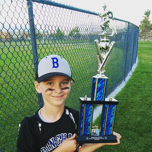 His team tied for first place and they pulled out their first tournament win..a squeakerby one run.  #howdenboysbaseball #thetrophyisbiggerthanhim