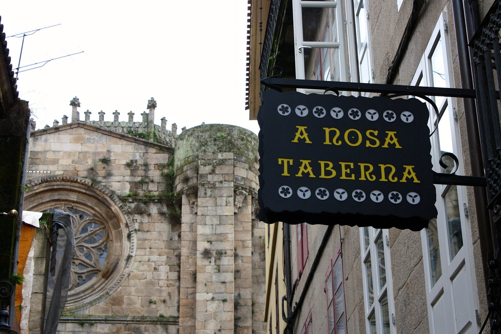 Galician words and lettering on a shop sign in Ourense, Spain
