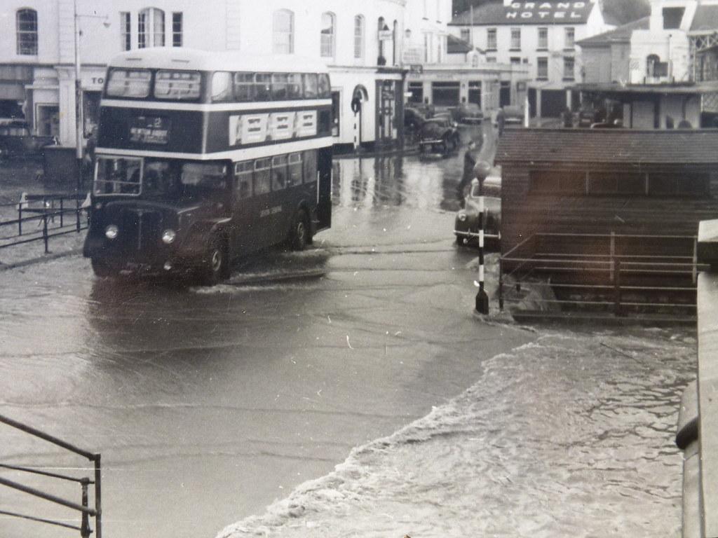 devon general aec regent iii bus passing through flooding