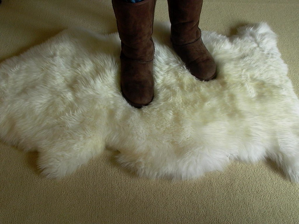 Chocolate Brown Tall Ugg Boots On Sheepskin Rug Tall