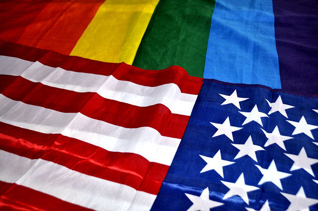 An American flag and an LGBTQ flag. (Blanca Florance/Flickr)