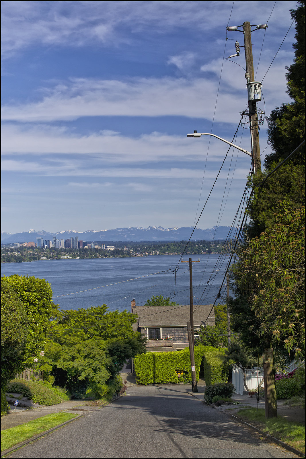 View of the City of Bellevue & Cascade Mountain Range Across Lake Washington from Seattle