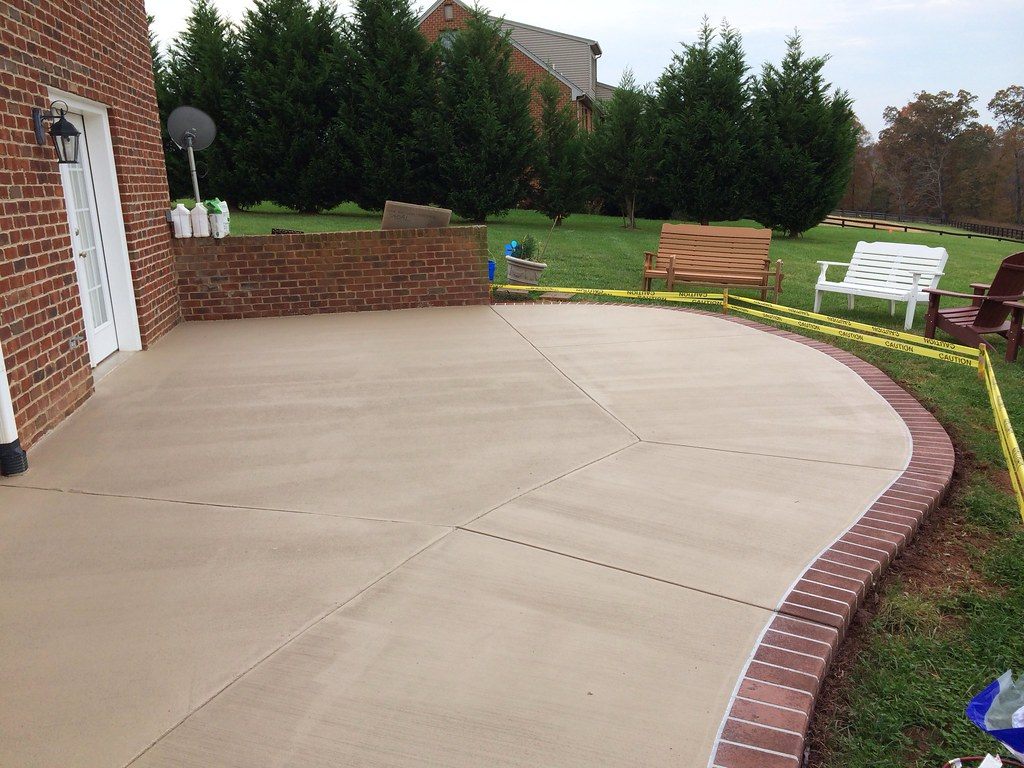 Stained Concrete Patio With A Sprayed Concrete Brick Borde
