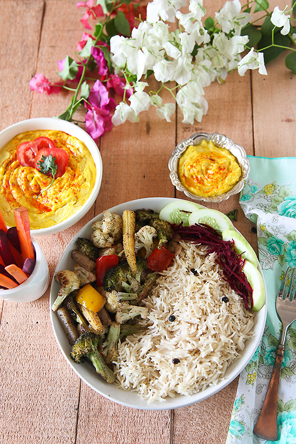 Turmeric Hummus With Sumac Roasted Vegetables And Black Pepper Rice