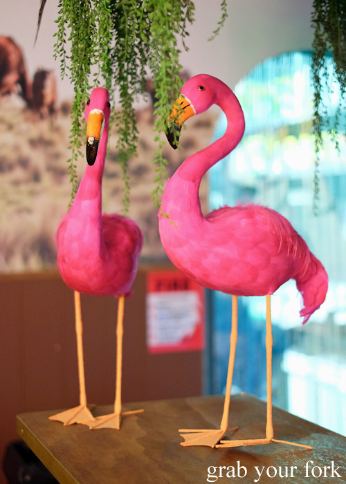 Pink flamingoes in the kitchen at Superior Burger, Wakeley
