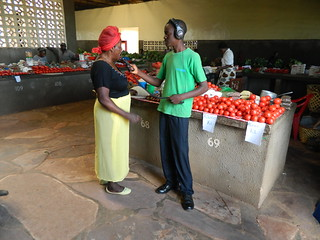 A student interviewing a market woman on the future she wants | by The World We Want 2015