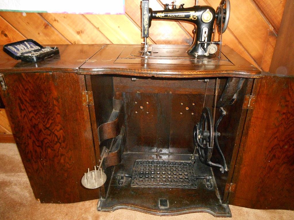 Faultless Antique Treadle Sewing Machine Parlor Cabinet